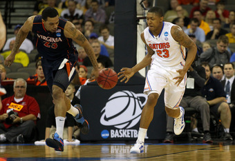 OMAHA, NE - MARCH 16:  Mike Scott #23 of the Virginia Cavaliers attempts to steal the ball from Bradley Beal #23 of the Florida Gators during the second round of the 2012 NCAA Men's Basketball Tournament at CenturyLink Center on March 16, 2012 in Omaha, N