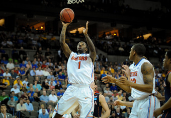 OMAHA, NE - MARCH 16: Kenny Boynton #1 of the Florida Gators drives in for a lay up against the Virginia Cavaliers during the second round of the NCAA Mens Basketball Tournament at CenturyLink Center March 16, 2012 in Omaha, Nebraska. (Photo by Eric Franc