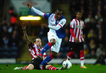 BLACKBURN, ENGLAND - MARCH 20:  Junior Hoilett of Blackburn Rovers battles with David Vaughan of Sunderland during the Barclays Premier League match between Blackburn Rovers and Sunderland at Ewood park on March 20, 2012 in Blackburn, England.  (Photo by