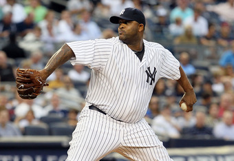 NEW YORK, NY - JULY 26:  CC Sabathia #52 of the New York Yankees pitches against the Seattle Mariners on July 26, 2011 at Yankee Stadium in the Bronx borough of New York City.  (Photo by Jim McIsaac/Getty Images)