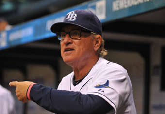 ST. PETERSBURG, FL - AUGUST 8:  Manaager Joe Maddon #70 of the Tampa Bay Rays questions a call against the Kansas City Royals August 8, 2011 at Tropicana Field in St. Petersburg, Florida. The Rays won 2 - 1. (Photo by Al Messerschmidt/Getty Images)