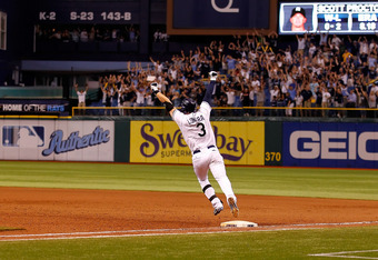 ST PETERSBURG, FL - SEPTEMBER 28:  Infielder Evan Longoria #3 of the Tampa Bay Rays rounds the bases after his bottom of the twelveth inning walk off home run against the New York Yankees during the game at Tropicana Field on September 28, 2011 in St. Pet