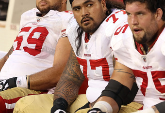 GLENDALE, AZ - DECEMBER 11:  (L-R) Jonathan Goodwin #59,  Mike Iupati #77 and Alex Boone #75 of the San Francisco 49ers react on the bench during the final moments of the NFL game against the Arizona Cardinals at the University of Phoenix Stadium on Decem