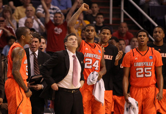 PHOENIX, AZ - MARCH 22:  Head coach Rick Pitino of the Louisville Cardinals looks up as Chane Behanan #24 and Wayne Blackshear #25 react from the bench in the first half while taking on the Michigan State Spartans during the 2012 NCAA Men's Basketball Wes