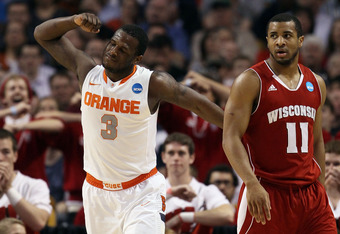 BOSTON, MA - MARCH 22:  Dion Waiters #3 of the Syracuse Orange reacts after a play as Jordan Taylor #11 of the Wisconsin Badgers looks on during their 2012 NCAA Men's Basketball East Regional Semifinal game at TD Garden on March 22, 2012 in Boston, Massac