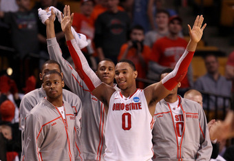 BOSTON, MA - MARCH 22:  Jared Sullinger #0 of the Ohio State Buckeyes celebrates from the bench towards the end of the game against the Cincinnati Bearcats during their 2012 NCAA Men's Basketball East Regional Semifinal game at TD Garden on March 22, 2012