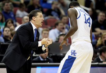 LOUISVILLE, KY - MARCH 17:  Head coach John Calipari of the Kentucky Wildcats talks with Michael Kidd-Gilchrist #14 in the second half against Iowa State Cyclones during the third round of the 2012 NCAA Men's Basketball Tournament at KFC YUM! Center on Ma