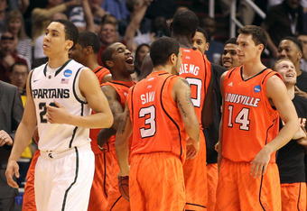 PHOENIX, AZ - MARCH 22:  Russ Smith #2 of the Louisville Cardinals reacts along with his teammates as Travis Trice #20 of the Michigan State Spartans walks by in the second half during the 2012 NCAA Men's Basketball West Regional Semifinal game at US Airw