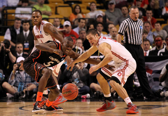 BOSTON, MA - MARCH 22:  Justin Jackson #5 of the Cincinnati Bearcats fights for the loose ball against Aaron Craft #4 of the Ohio State Buckeyes during their 2012 NCAA Men's Basketball East Regional Semifinal game at TD Garden on March 22, 2012 in Boston,