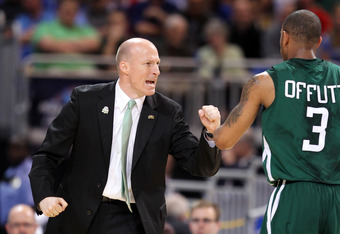 ST. LOUIS, MO - MARCH 23:  Head coach John Groce of the Ohio Bobcats reacts during a stop in play with Walter Offutt #3 in the first half against the North Carolina Tar Heels during the 2012 NCAA Men's Basketball Midwest Regional Semifinal at Edward Jones