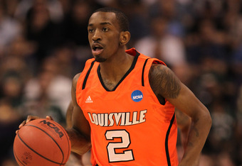 PHOENIX, AZ - MARCH 22:  Russ Smith #2 of the Louisville Cardinals moves the ball while taking on the Michigan State Spartans during the 2012 NCAA Men's Basketball West Regional Semifinal game at US Airways Center on March 22, 2012 in Phoenix, Arizona.  (