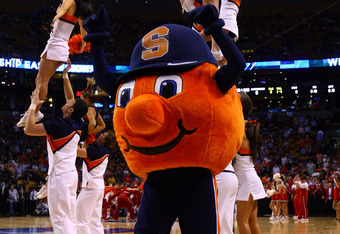 BOSTON, MA - MARCH 22:  The Syracuse Orange mascot performs during their 2012 NCAA Men's Basketball East Regional Semifinal game at TD Garden on March 22, 2012 in Boston, Massachusetts.  (Photo by Elsa/Getty Images)