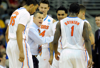 OMAHA, NE - MARCH 18:  Head coach Billy Donovan of the Florida Gators talks with his players at a timeout in the seocnd half against the Norfolk State Spartans during the third round of the 2012 NCAA Men's Basketball Tournament at CenturyLink Center on Ma