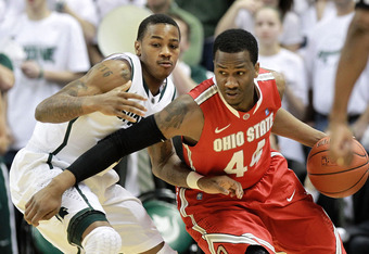 EAST LANSING, MI - MARCH 04:  William Buford #44 of the Ohio State Buckeyes drives the ball around Keith Appling #11 of the Michigan State Spartans during the second half of the game at Breslin Center on March 4, 2012 in East Lansing, Michigan. Ohio State