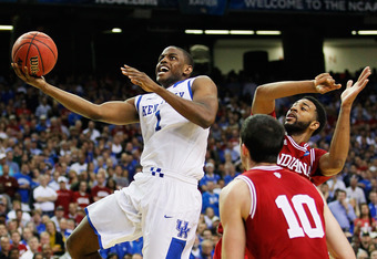 ATLANTA, GA - MARCH 23:  Darius Miller #1 of the Kentucky Wildcats shoots past Christian Watford #2 and Will Sheehey #10 of the Indiana Hoosiers in the second half during the 2012 NCAA Men's Basketball South Regional Semifinal game at the Georgia Dome on
