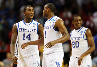 ATLANTA, GA - MARCH 23:  Michael Kidd-Gilchrist #14, Darius Miller #1 and Doron Lamb #20 of the Kentucky Wildcats react during their 102 to 90 win over the Indiana Hoosiers during the 2012 NCAA Men's Basketball South Regional Semifinal game at the Georgia