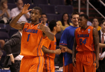 PHOENIX, AZ - MARCH 22:  Kenny Boynton #1 of the Florida Gators reacts in the second half while taking on the Marquette Golden Eagles during the 2012 NCAA Men's Basketball West Regional Semifinal game at US Airways Center on March 22, 2012 in Phoenix, Ari