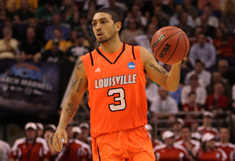 PHOENIX, AZ - MARCH 22:  Peyton Siva #3 of the Louisville Cardinals moves the ball while taking on the Michigan State Spartans during the 2012 NCAA Men's Basketball West Regional Semifinal game at US Airways Center on March 22, 2012 in Phoenix, Arizona.
