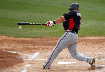JUPITER, FL - MARCH 13: Tyler Pastornicky #1 of the Atlanta Braves bats during a game against the Miami Marlins at Roger Dean Stadium on March 13, 2012 in Jupiter, Florida.  (Photo by Sarah Glenn/Getty Images)