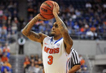 GAINESVILLE, FL -  NOVEMBER 11:  Guard Mike Rosario #3 of the Florida Gators sets for a shot against the Jackson State Tigers November 11, 2011 at the Stephen C. O'Connell Center in Gainesville, Florida.  Rosario scored 19 points and the Gators won 99 - 5