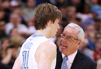 ST. LOUIS, MO - MARCH 23:  Gead coach Roy Williams of the North Carolina Tar Heels talks with Stilman White #11  in the first half against the Ohio Bobcats during the 2012 NCAA Men's Basketball Midwest Regional Semifinal at Edward Jones Dome on March 23,