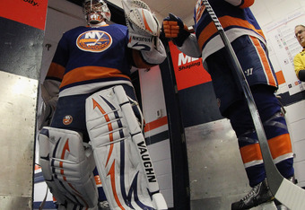 UNIONDALE, NY - OCTOBER 15: Evgeni Nabokov #20 of the New York Islanders walks out to play against the New York Rangers at the Nassau Veterans Memorial Coliseum on October 15, 2011 in Uniondale, New York. The Islanders defeated the Rangers 4-2.  (Photo by