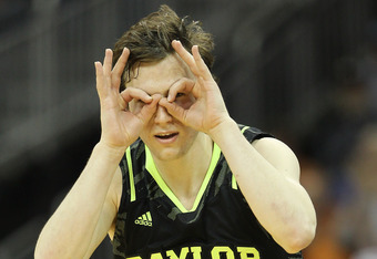 KANSAS CITY, MO - MARCH 09:  Brady Heslip #5 of the Baylor Bears celebrates a three pointer in the second half against the Kansas Jayhawks during the semifinals of the 2012 Big 12 Men's Basketball Tournament at Sprint Center on March 9, 2012 in Kansas Cit