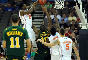 OMAHA, NE - MARCH 18:  Casey Prather #24 of the Florida Gators blocks a shot attempt in the first half by Kyle O'Quinn #10 of the Norfolk State Spartans during the third round of the 2012 NCAA Men's Basketball Tournament at CenturyLink Center on March 18,