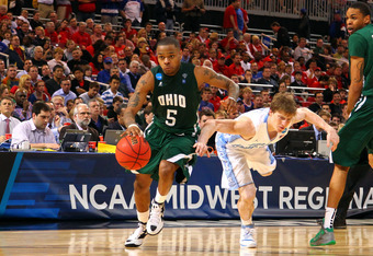 ST. LOUIS, MO - MARCH 23:  D.J. Cooper #5 of the Ohio Bobcats drives in the second half past Stilman White #11 of the North Carolina Tar Heels during the 2012 NCAA Men's Basketball Midwest Regional Semifinal at Edward Jones Dome on March 23, 2012 in St. L