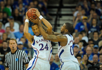OMAHA, NE - MARCH 18: Travis Releford #24 and Thomas Robinson #0 of the Kansas Jayhawks bring down a rebound during the second round of the NCAA Mens Basketball Tournament at CenturyLink Center March 18, 2012 in Omaha, Nebraska. (Photo by Eric Francis/Get