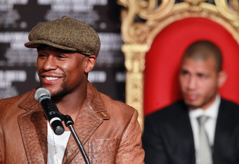 HOLLYWOOD, CA - MARCH 01:  Floyd Mayweather smiles during a press conference to promote his upcoming fight against Miguel Cotto on May 5 at the MGM Grand in Las Vegas at Grauman's Chinese Theatre on March 1, 2012 in Hollywood, California.  (Photo by Jeff