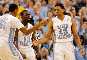 GREENSBORO, NC - MARCH 18:  (R) James Michael McAdoo #43 of the North Carolina Tar Heels celebrates after making a basket with teammates John Henson #31 and P.J. Hairston #15 in the first half against the Creighton Bluejays during the third round of the 2