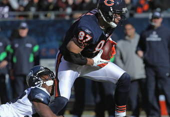 CHICAGO, IL - DECEMBER 18: Kellen Davis #87 of the Chicago Bears breaks away from a tackle attempt by David Hawthorne #57 of the Seattle Seahawks at Soldier Field on December18, 2011 in Chicago, Illinois. The Seahawks defeated the Bears 38-14. (Photo by J
