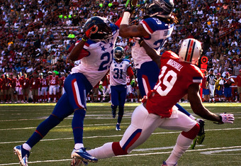 HONOLULU, HI - JANUARY 29:  Earl Thomas #29 of the Seattle Seahawks and Corey Graham #21 of the Chicago Bears attempt to intercept a pass intended for Brandon Marshall #19 of the Miami Dolphins during the 2012 NFL Pro Bowl at Aloha Stadium on January 29,