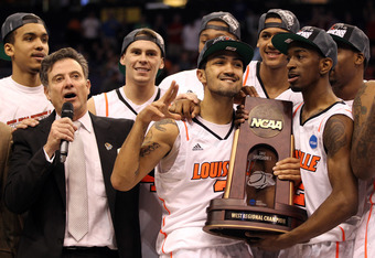 PHOENIX, AZ - MARCH 24:  Head coach Rick Pitino, Peyton Siva #3 and Russ Smith #2 of the Louisville Cardinals celebrate after defeating the Florida Gators 72-68 during the 2012 NCAA Men's Basketball West Regional Final at US Airways Center on March 24, 20