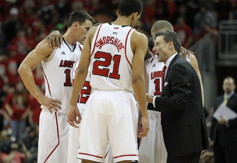 LOUISVILLE, KY - DECEMBER 17:  Rick Pitino the head coach of the Louisville Cardinals gives instructions to his team during the game against the Memphis Tigers  at KFC YUM! Center on December 17, 2011 in Louisville, Kentucky.  (Photo by Andy Lyons/Getty I