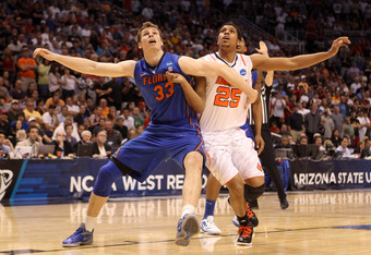 PHOENIX, AZ - MARCH 24:  Erik Murphy #33 of the Florida Gators blocks out Wayne Blackshear #25 of the Louisville Cardinals in the second half during the 2012 NCAA Men's Basketball West Regional Final at US Airways Center on March 24, 2012 in Phoenix, Ariz