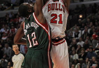 CHICAGO, IL - FEBRUARY 22:  Jimmy Butler #21 of the Chicago Bulls shoots over Luc Mbah a Moute #12 of the Milwaukee Bucks at the United Center on February 22, 2012 in Chicago, Illinois. The Bulls defeated the Bucks 110-91. NOTE TO USER: User expressly ack