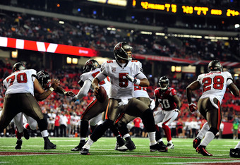 ATLANTA, GA - JANUARY 01: Josh Freeman #5 of the Tampa Bay Buccaneers drops back to pass against the Atlanta Falcons during play at the Georgia Dome on January 1, 2012 in Atlanta, Georgia. The Falcons won 45-24. (Photo by Grant Halverson/Getty Images)