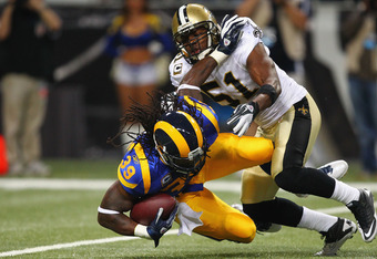 ST. LOUIS, MO - OCTOBER 30: Steven Jackson #39 of the St. Louis Rams is tackled in the backfield byJonathan Vilma #51 of the New Orleans Saints at the Edward Jones Dome on October 30, 2011 in St. Louis, Missouri.  The Rams beat the Saints 31-21.  (Photo b