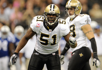 NEW ORLEANS, LA - OCTOBER 23:  Jonathan Vilma #51 of the New Orleans Saints calls a defensive play during a game against the Indianapolis Colts being held at Mercedes-Benz Superdome on October 23, 2011 in New Orleans, Louisiana.  The Saints defeated the C