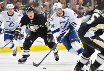 PITTSBURGH, PA - FEBRUARY 25: Brett Connolly #14 of the Tampa Bay Lightning skates with the puck against the Pittsburgh Penguins on February 25, 2012 at CONSOL Energy Center in Pittsburgh, Pennsylvania. (Photo by Jamie Sabau/Getty Images)
