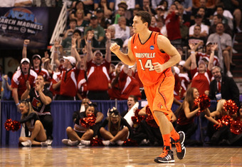 PHOENIX, AZ - MARCH 22:  Kyle Kuric #14 of the Louisville Cardinals reacts as the Cardinals take on the Michigan State Spartans during the 2012 NCAA Men's Basketball West Regional Semifinal game at US Airways Center on March 22, 2012 in Phoenix, Arizona.