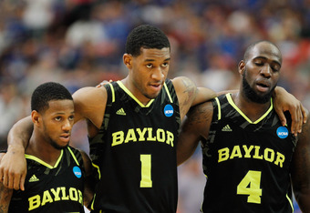 ATLANTA, GA - MARCH 25:  Pierre Jackson #55, Perry Jones III #1 and Quincy Acy #4 of the Baylor Bears react in the second half against the Kentucky Wildcats during the 2012 NCAA Men's Basketball South Regional Final at the Georgia Dome on March 25, 2012 i