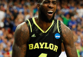 ATLANTA, GA - MARCH 25:  Quincy Acy #4 of the Baylor Bears reacts in the first half against the Kentucky Wildcats during the 2012 NCAA Men's Basketball South Regional Final at the Georgia Dome on March 25, 2012 in Atlanta, Georgia.  (Photo by Kevin C. Cox