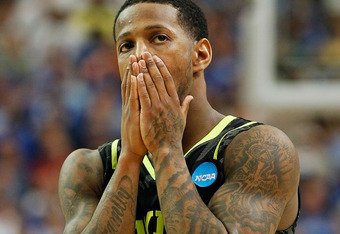 ATLANTA, GA - MARCH 25:  Pierre Jackson #55 of the Baylor Bears reacts in the second half against the Kentucky Wildcats during the 2012 NCAA Men's Basketball South Regional Final at the Georgia Dome on March 25, 2012 in Atlanta, Georgia.  (Photo by Kevin