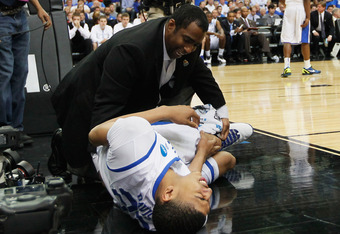 ATLANTA, GA - MARCH 25:  Anthony Davis #23 of the Kentucky Wildcats reacts after being injured against the Baylor Bears during the 2012 NCAA Men's Basketball South Regional Final at the Georgia Dome on March 25, 2012 in Atlanta, Georgia.  (Photo by Kevin
