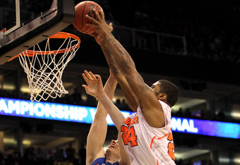 PHOENIX, AZ - MARCH 24:  Chane Behanan #24 of the Louisville Cardinals dunks the ball over Erik Murphy #33 of the Florida Gators in the first half during the 2012 NCAA Men's Basketball West Regional Final at US Airways Center on March 24, 2012 in Phoenix,