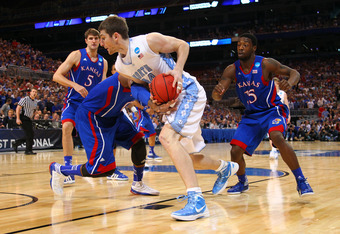 ST LOUIS, MO - MARCH 25:  Tyler Zeller #44 of the North Carolina Tar Heels drives inside in the first half against Thomas Robinson #0 (obscured) of the Kansas Jayhawks during the 2012 NCAA Men's Basketball Midwest Regional Final at Edward Jones Dome on Ma