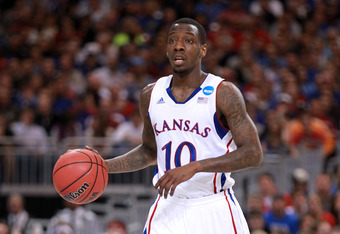 ST. LOUIS, MO - MARCH 23:  Tyshawn Taylor #10 of the Kansas Jayhawks brings the ball up court in the first half against the North Carolina State Wolfpack during the 2012 NCAA Men's Basketball Midwest Regional Semifinal at Edward Jones Dome on March 23, 20